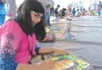 Children paint portraits of legendary artists